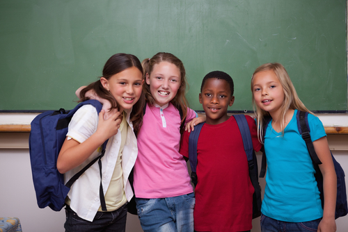 Stock Photo: Children Standing in Classroom