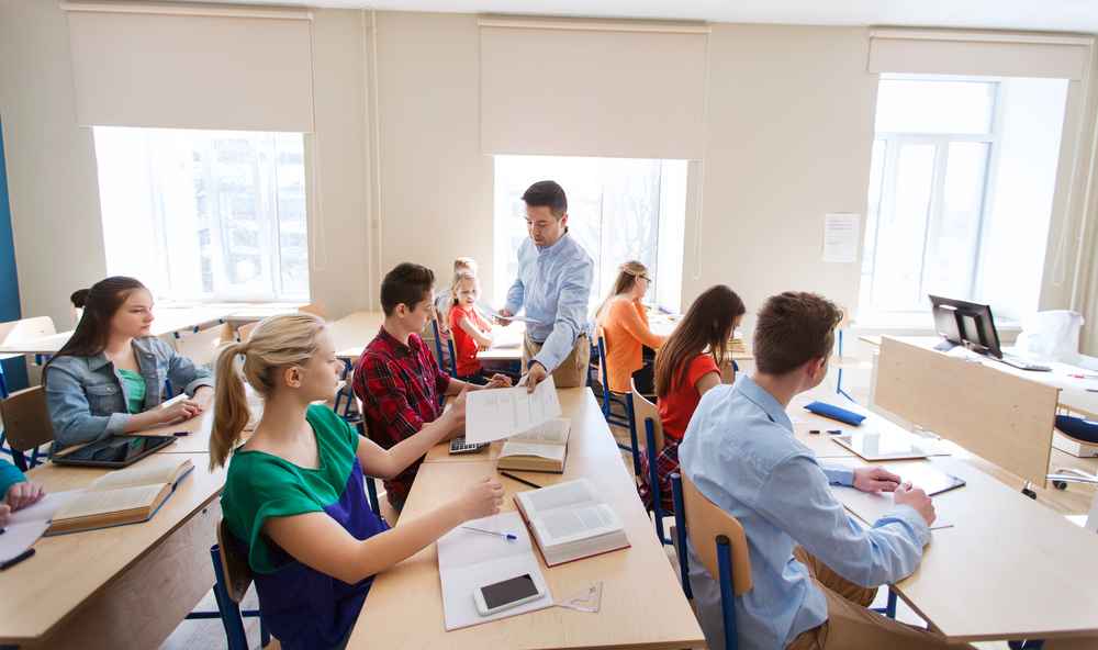 male teacher in high school classroom