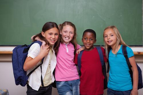 Stock Photo: Children Standing in Classroom